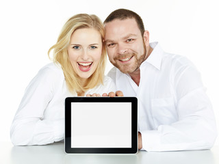 Couple presenting tablet pc with copyspace