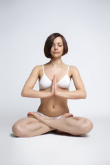 woman sit in yoga pose - lotos