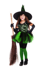 happy halloween witch in green dress holding broom