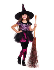 smiling halloween witch holding broom full length