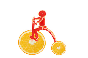 Healthy eating. Funny vintage bike  made of the orange  slices w