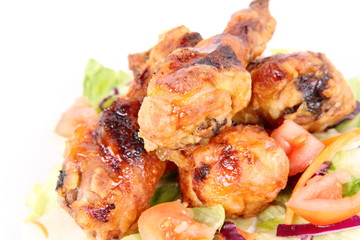 Fried chicken legs with side salad decorated with basil