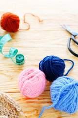 knitting background, yarn with accessories