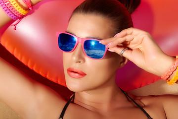 Fashion Girl Portrait. Beautiful Young Woman Sunbathing