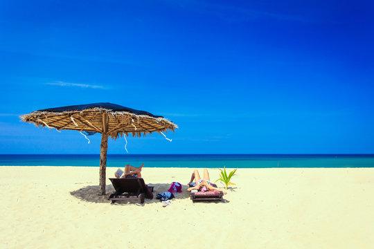 Sun umbrella on the white beach
