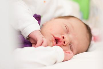 Peaceful newborn baby sleeping