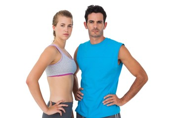 Portrait of a sporty young couple with hands on hips