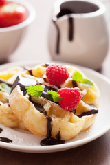 Belgian waffles with chocolate and raspberry for breakfast