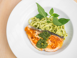Spaghetti and salmon in pesto sauce