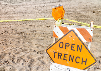 Construction site barrier,open trench warning sign,closeup.