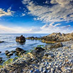 sea wave breaks about boulders