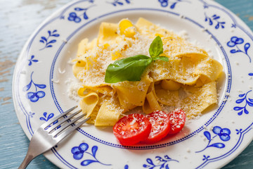Pasta with tomato and basil on the plate