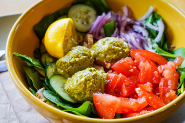 Protein salad with vegetables and hummus