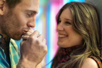 Attractive heterosexual couple kissing in Montreal