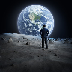 Fototapete - Man standing on the moon, looking at the Earth