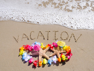 "Sign ""Vacation"" on the sandy beach with starfishes"