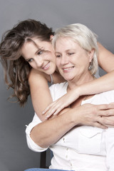 Daughter holding mother close in an embrace