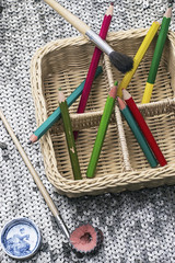 pencils for drawing stacked in a woven basket