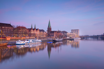 Wall Mural - Bremen city by river at sunset