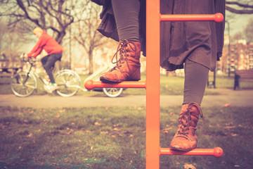 Woman climbing at playground