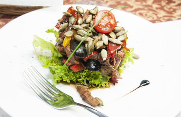 Warm salad of beef and vegetables in a restaurant
