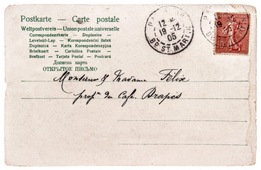 old handwritten postcard letter with stamp and text