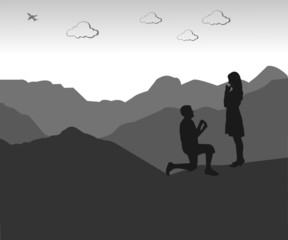 Romantic proposal on top of the mountain silhouette