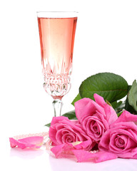 Composition with pink sparkle wine in glass and pink roses