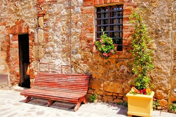 Fotomurales - Bench along a medieval stone house in Tuscany, Italy