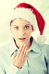 Young business woman in santa hat