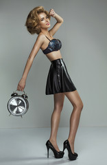 Beautiful sexy pin-up girl with clock