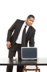 Businessman of african ethnicity, studio portrait,