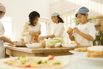 Japanese girl and mother cooking in kitchen