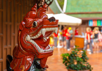Red wooden dragon at the entrance of the Loro Parque