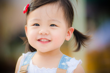 Asian little girl with a huge smile on her face