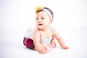 A smiling Asian little baby girl with a lovely handband