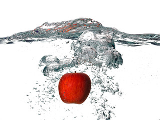 Red Apple Falling into the Fresh Water Isolated on White