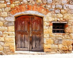 Wall Mural - Medieval stone house with rustic door, Tuscany, Italy