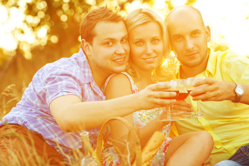 Summer weekend concept. Happy friends at picnic