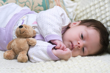 Cute funny infant baby with toy bear