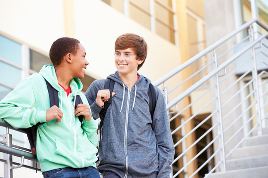 Two Male High School Students Standing Outside Building