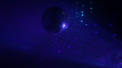 Wall Mural - Rotating disco ball with multicolor light effect and dense smoke