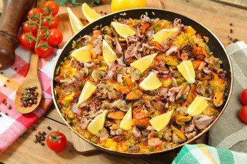 Paella on wooden table
