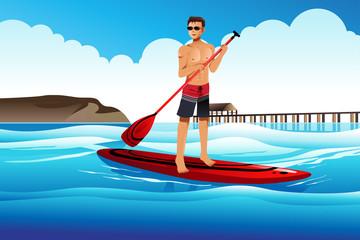 Man paddle boarding in the ocean