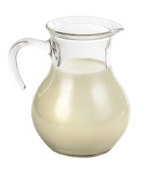 Clear glass jug with milk
