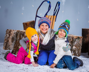 Funny kids in winter clothes