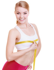 Fitness girl sporty woman measuring her bust size isolated