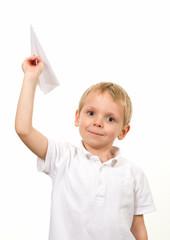 Cute blond boy holding a paper plane