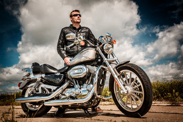 Wall Mural - Biker on the road
