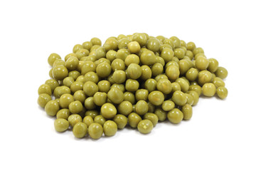 handful of green peas on a a white background